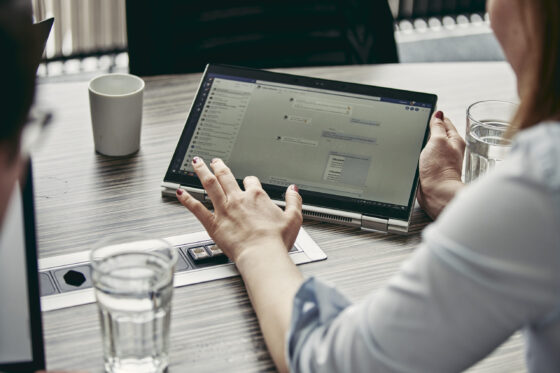Woman using touch function on laptop